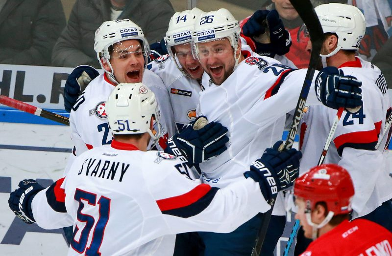 MOSCOW, RUSSIA - JANUARY 17, 2017: Slovan Bratislava's Nick Plastino, Ziga Jeglic, Igor Musatov (from L facing the camera), and Ivan Svarny (L front) celebrate a goal against Spartak Moscow in their 2016/2017 KHL Regular Season ice hockey match at Luzhniki Arena. Sergei Fadeichev/TASS (Photo by Sergei FadeichevTASS via Getty Images)